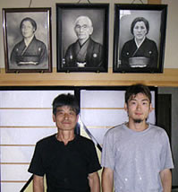 Igarashi and his son in front of ancestors' picture